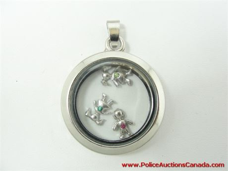 auctions canada silver tone floating locket
